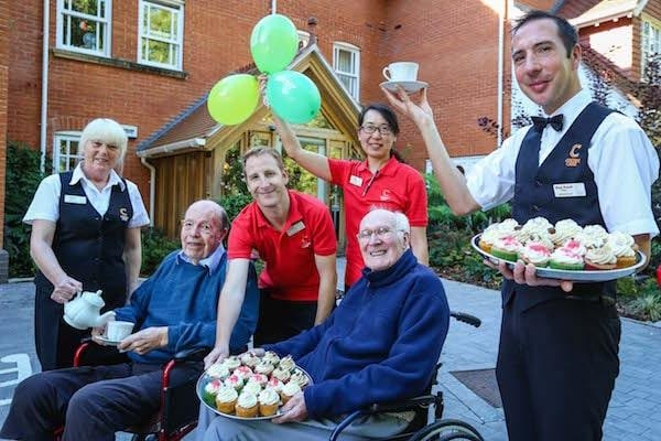 Colten Care residents and team members enjoy the Macmillan World's Biggest Coffee Morning. Pictured are staff Nina Upwood, Justin Corder, Lilly Chiu and Mark Newell with residents Ian Milroy and John Griffin.