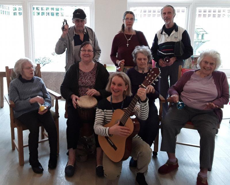 Music and Arts Partner Fiona Pritchard, front centre, with residents and relatives at The Aldbury dementia care home in Poole.