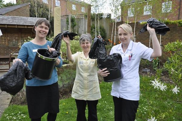 WASTE NOT. Following a new approach piloted at a Dorset home, Colten Care expects to avoid using some 365,000 plastic bin liners. Pictured, from left, are Colten Care team members: Jo Ellis, Carol Martin and Gill Holland.