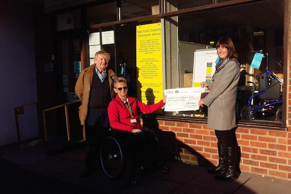 Mayor Anne Corbridge presents Jacqui Keable from New Forest Disability Information Service with a cheque for £10,000