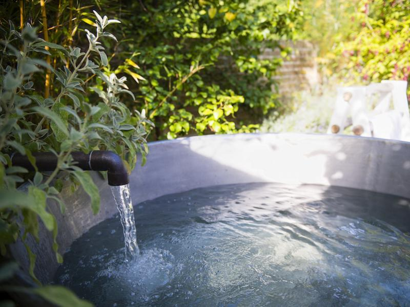 Outdoor bath at Herb House Lime Wood